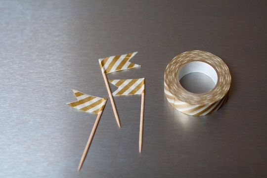 Toothpicks plus washi tape equals lil homemade flag! (cut out a triangle of flag to look even cooler.) a must have for the cupcakes. :)