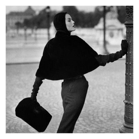 Vogue - September 1955 by Henry Clarke.  Here, photographer Henry Clarke captures the Balmain ideal