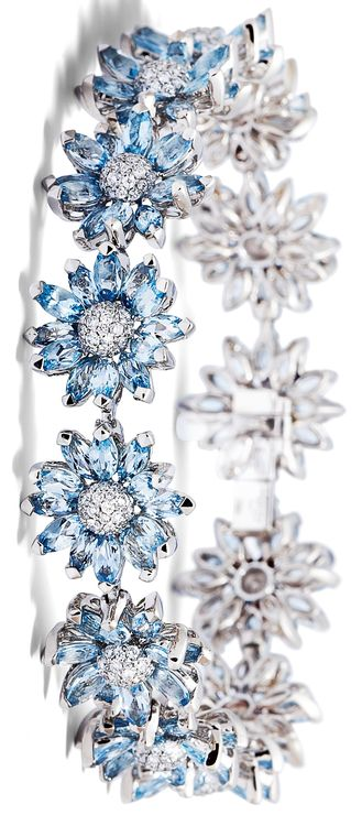 Asprey Daisy Heritage Bracelet, Aquamarine. Revisiting the house's archives, Asprey jewellery designers have modified some of the most cherished Daisy Collection classics to create new editions of iconic favourites. Created by the Asprey craftsmen, the Daisy Heritage Bracelet has been individually set with marquise cut aquamarine petals and a pavé diamond centre, set in 18ct white gold