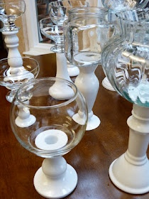diy buffet stands, thrift store candle sticks and glass bowls/vases, spray paint white and glue together