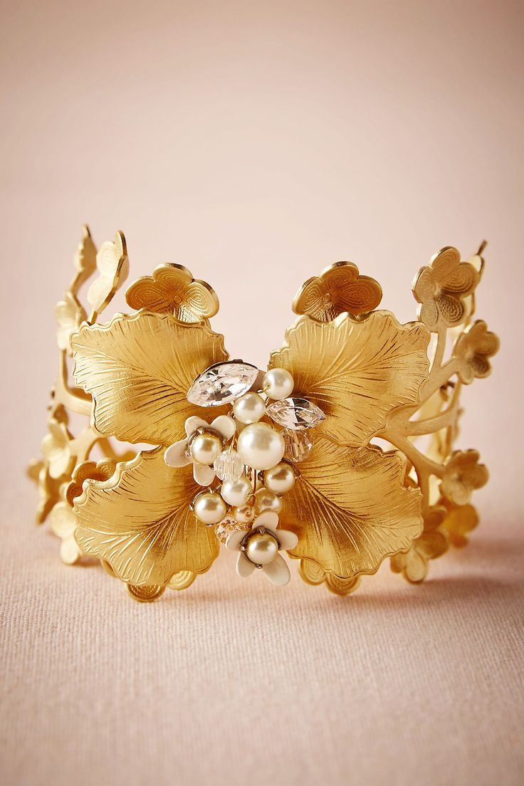Arboreta Bracelet from @BHLDN. Gilded petals and pearls are arranged into the most beautiful blooms on this statement piece. 'From Paris' by Debra Moreland. Foldover clasp, 14k gold-plate, glass pearls, Swarovski crystals.     Handmade in USA.