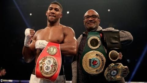 """Anthony Joshua stopped Carlos Takam in the 10th round to defend his WBA and IBF world heavyweight titles  Anthony  Joshua says """"the possibilities of 2018 are great"""" after cementing a  record-breaking year with a dogged win over Carlos Takam.  The  British WBA and IBF heavyweight champion built on his April win over  Wladimir Klitschko by stopping Takam in 10 rounds at a captivated  Principality Stadium in Cardiff. His promoter Eddie Hearn says a  meeting with WBC champion Deontay Wilder """"has…"""