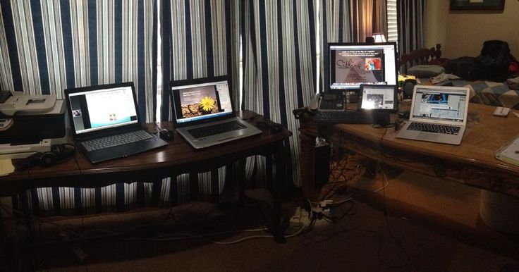 Jennifer Smolka's command central! @321eConference 3 laptops, 1 desktop, 1 iPad, and an iPhone!