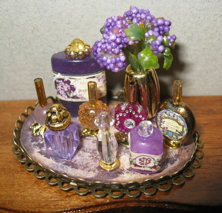 Dollhouse miniature vanity tray with lilac perfumes, powder and flowers