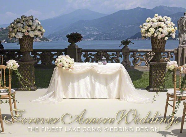 Lake Como weddings. Ceremony on Lake Terrace of beautiful Villa Balbianello. Detail of the officiant's table with custom made silk and organza tablecloth. Giant medician, wrought iron vases with important flower composition. Picture by ForeverAmoreWeddings ©