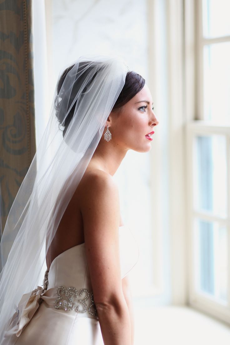 Love the placement of her veil and the veil itself. Most people do under the hairstyle but this is stunning!