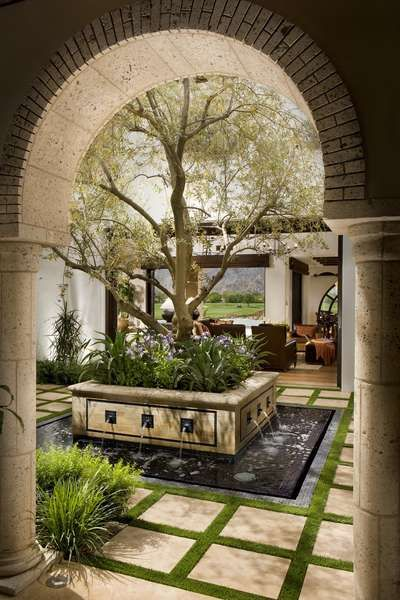 Interior courtyard classic spanish revival south coast for Spanish style house plans with interior courtyard