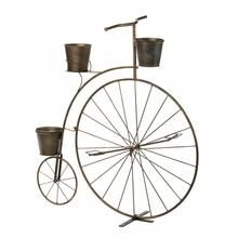 Vintage charm is in bloom! This adorable planter's frame looks like a high-wheel bicycle from bygone days, with one large wheel in the front and a smaller wheel
