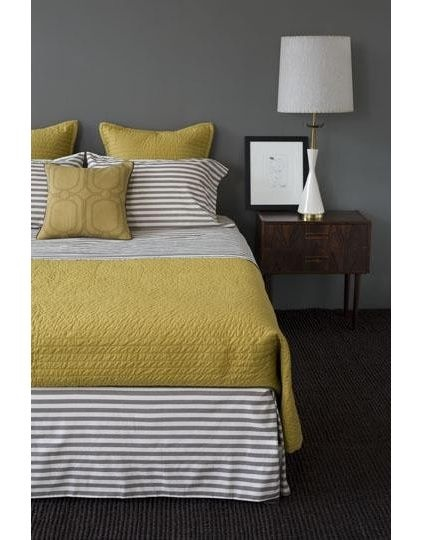 From Houzz.com:  I could see the Mr. being ok with this mustard/gray color scheme in your room... the stripes make it more masculine. ;-) @Holly Tollison