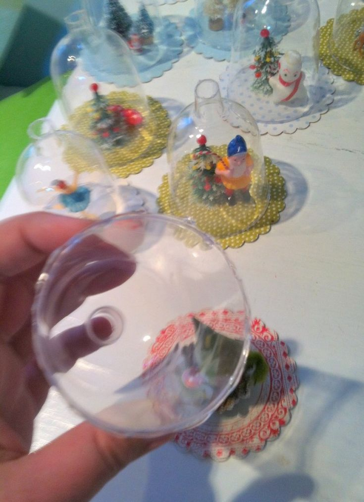 $ Tree plastic wine glasses with bottom removed. Punch scallop circles out of chipboard, create scene on circles using hot glue,. Run a bead of hot glue around the bottom of wine glass, ,center it over circle and press down.