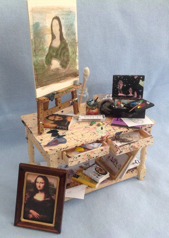 DOLLS HOUSE MINIATURES - 1/12TH SCALE Dolls House Miniatures - Artists table Paint stained Pine table, loaded with sketches and drawings,
