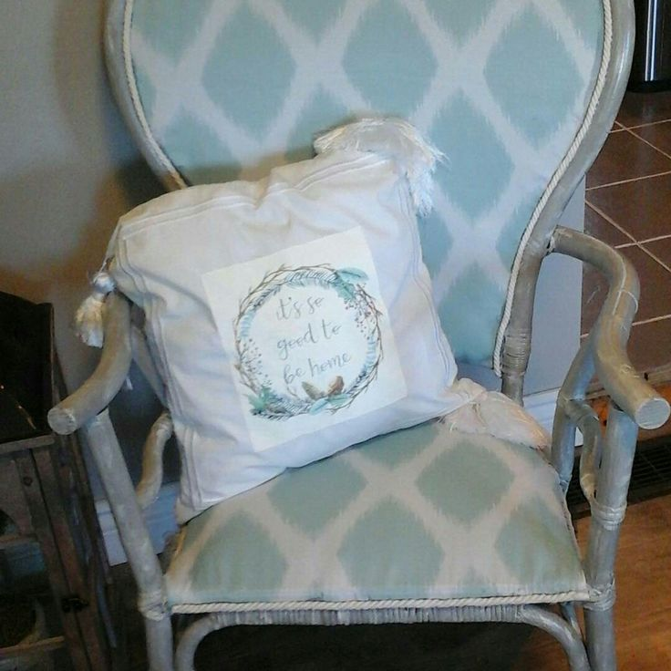 with a little bit of chalk paint  and fabric, this old ratan chair turned out so cute