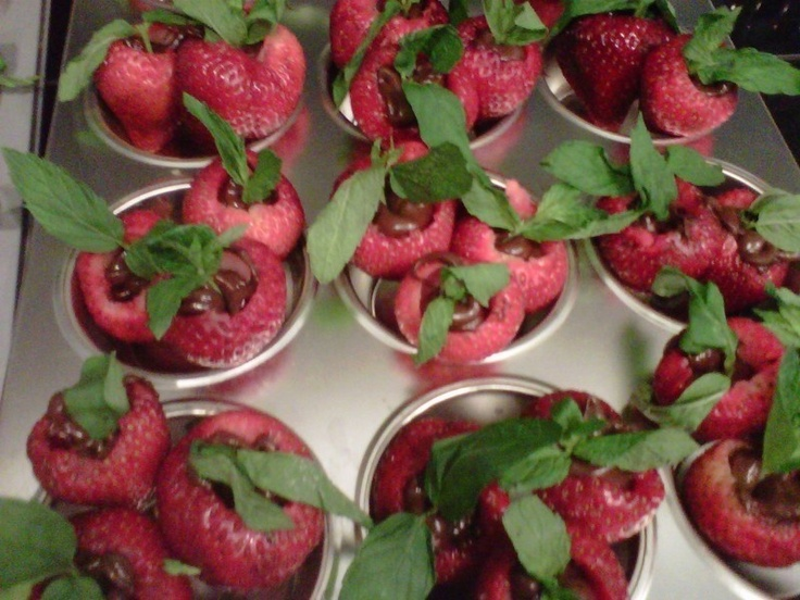 Chocolate Filled Strawberries with Mint Leaves