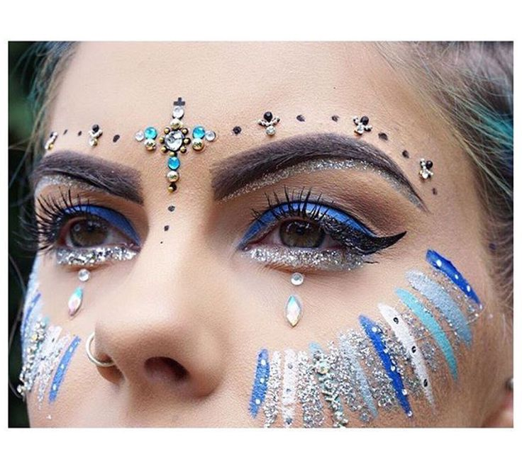 Blue glitter and face paint                                                                                                                                                                                 More