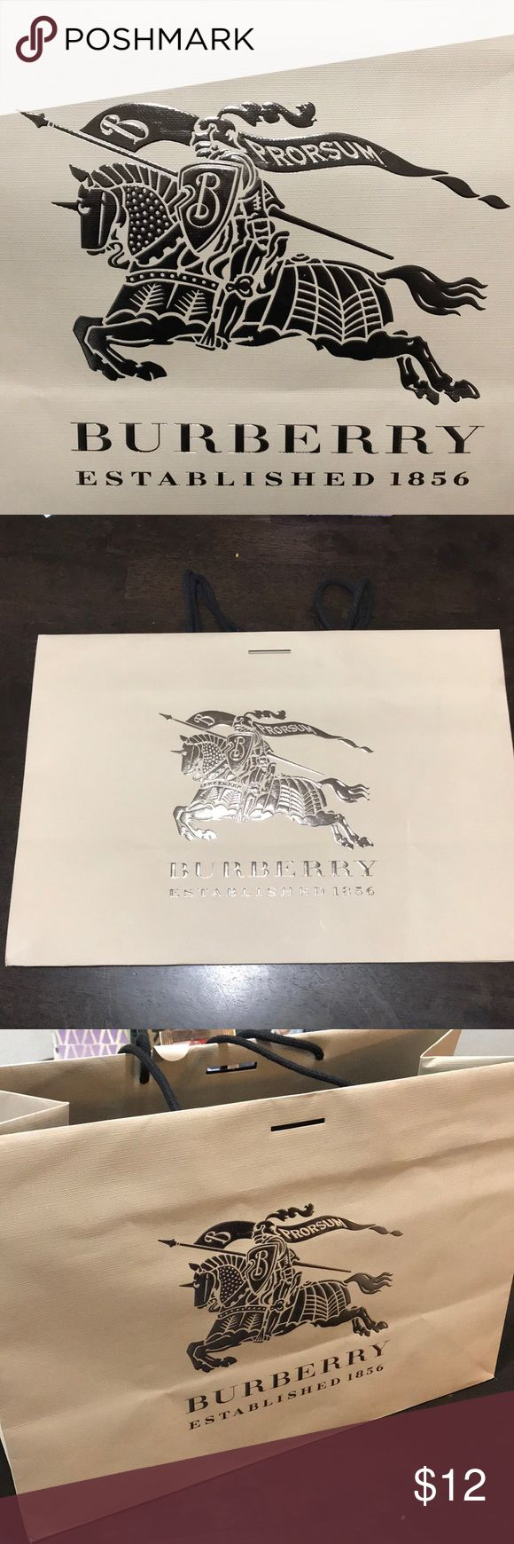 Burberry shopping bag Burberry shopping bag. Ribbon not included- bag has a few crinkles to it. It's from the flagship store in London   Bundle 3+ items for an automatic 15% discount Burberry Bags