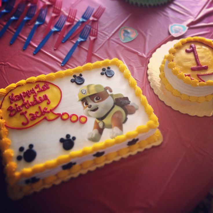 For baby J's Paw Patrol themed first birthday party, we got circus colored decorations. Since the show is very new, there isn't any merchandise available so we used some of the free printables on Nick Jr.'s website to make a banner, hats, mini banner for the high chair and the poster. We got the bakery to do an edible image of Rubble and matching smash cake and we love how it turned out!