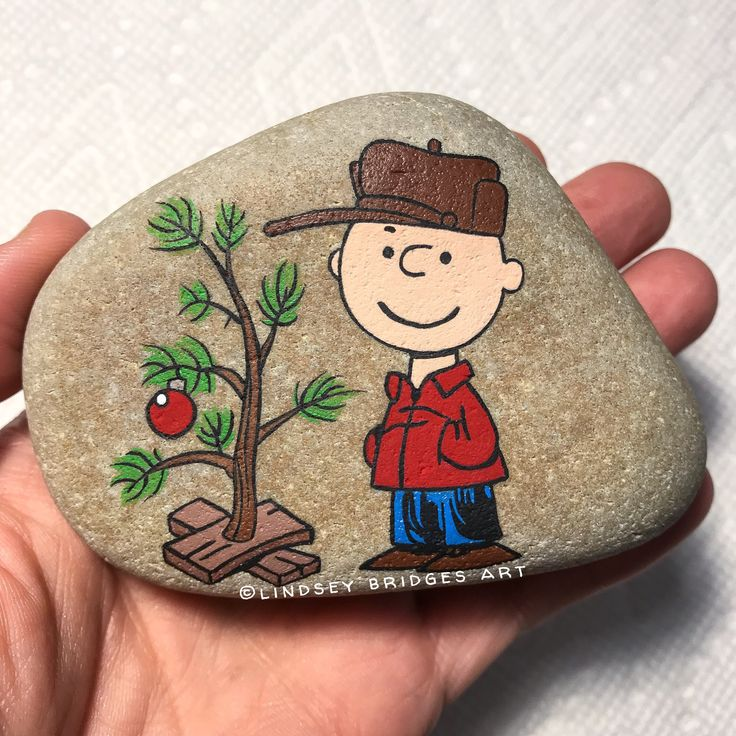 Charlie Brown Christmas painted rock  by Lindsey Bridges   #christmas #paintedrock #rockpainting #charliebrownchristmas #charliebrownrock #paintedstone #stonepainting #rockart #artrock #stoneart