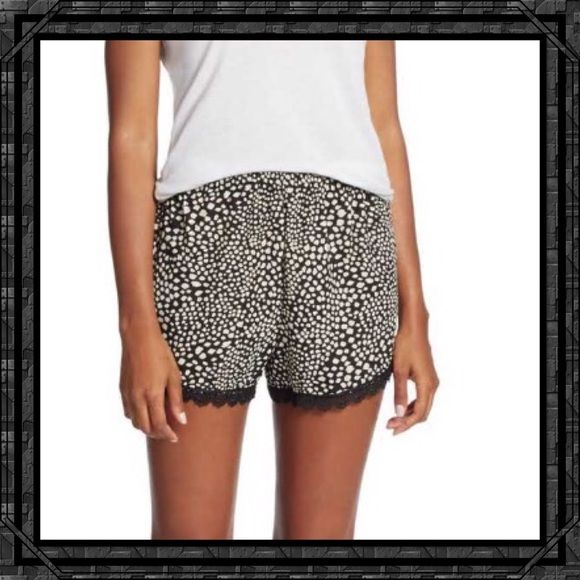 "HOST PICKLace-Trimmed Shorts from Saks Off 5th These shorts have a black Lacey trim with an elastic waistline. Comfortable enough to sleep in with your favorite sleep shirt or pair with a cute top to wear during the day. In-seam about 2.5"". Rayon. NWT. Saks Off 5th Shorts"