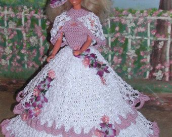 (1) CROCHET FASHION DOLL PATTERN FOR 11 1/2 Fashion Dolls such as Barbie. This is a pattern NOT the finished product.  #257 PARADE OF ROSES #3- Design from ICS Original Designs- Make with #10 Crochet Thread.  If you would like to have the patterns emailed to you rather than mailed shipping will be FREE but please let me know with your payment that this is what you want.  Buyers outside the USA patterns are available through email only.  THESE PATTERNS ARE FOR PERSONAL USE ONLY AND ARE NO...