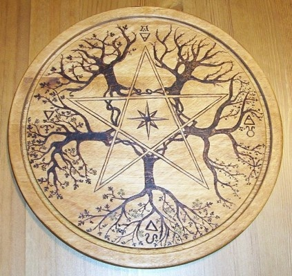 nice pentacle - used as a 'paten' on the altar - paten is an altar tile (sometimes made of wood, sometimes of tile or other hard substance) - usually takes center space on the altar, some will place their hot items, such as a hot cauldron, upon the paten during ritual/spellwork.