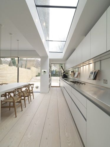White stainless steel and light wood large skylight - kitchen