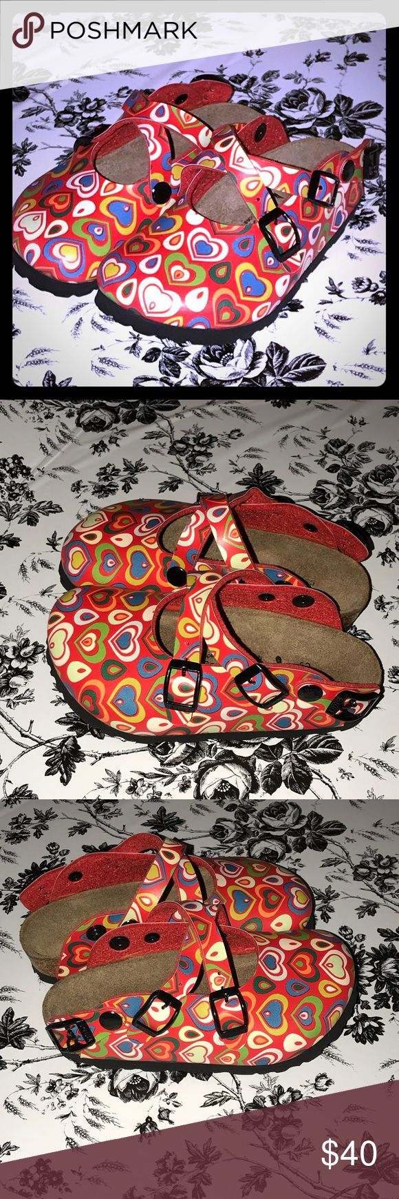 Kids Birki's with hearts in a red color Size 27 A cute new pair of kids Birki's size 27. The only flaw is they are missing the back strip, see photos. Birkenstock Shoes Sandals & Flip Flops
