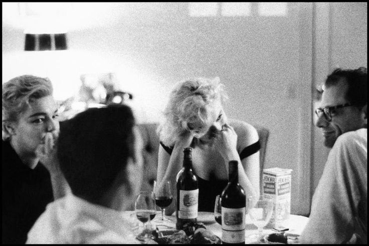 Yves Montand who is watching Marilyn Monroe who is watching Arthur Miller. Simone Signoret is watching Yves Montand (her husband at the time) watch Marilyn.