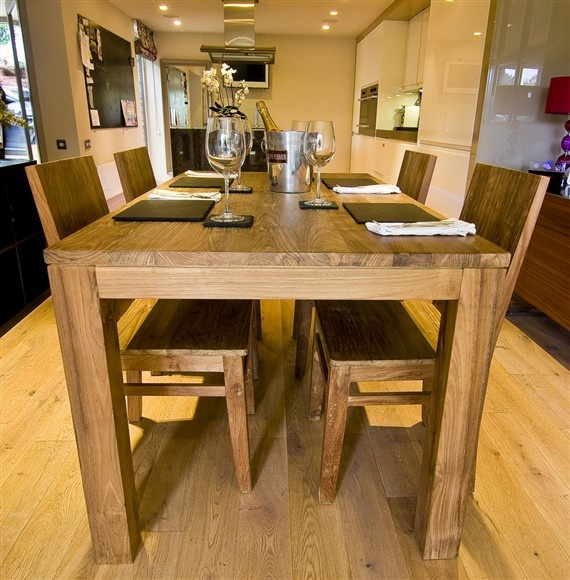 The 'Pusuk' Dining Set – a beautiful and unique, solid wood table made from reclaimed teak and four wooden chairs.