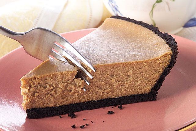 A creamy filling flavored with instant coffee is baked in a prepared chocolate-sandwich-cookie crust for an easy, luscious cheesecake.
