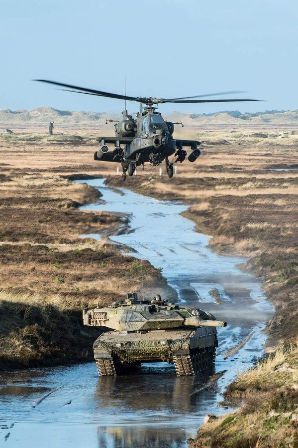 Danish Leopard 2A5 tank on exercise with US Army Apache helicopter