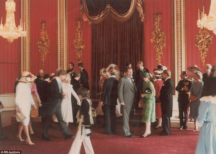 Grand: The princess' veil can be seen as she stands next to her new husband, the Prince of Wales, as royals gather in the Throne Room