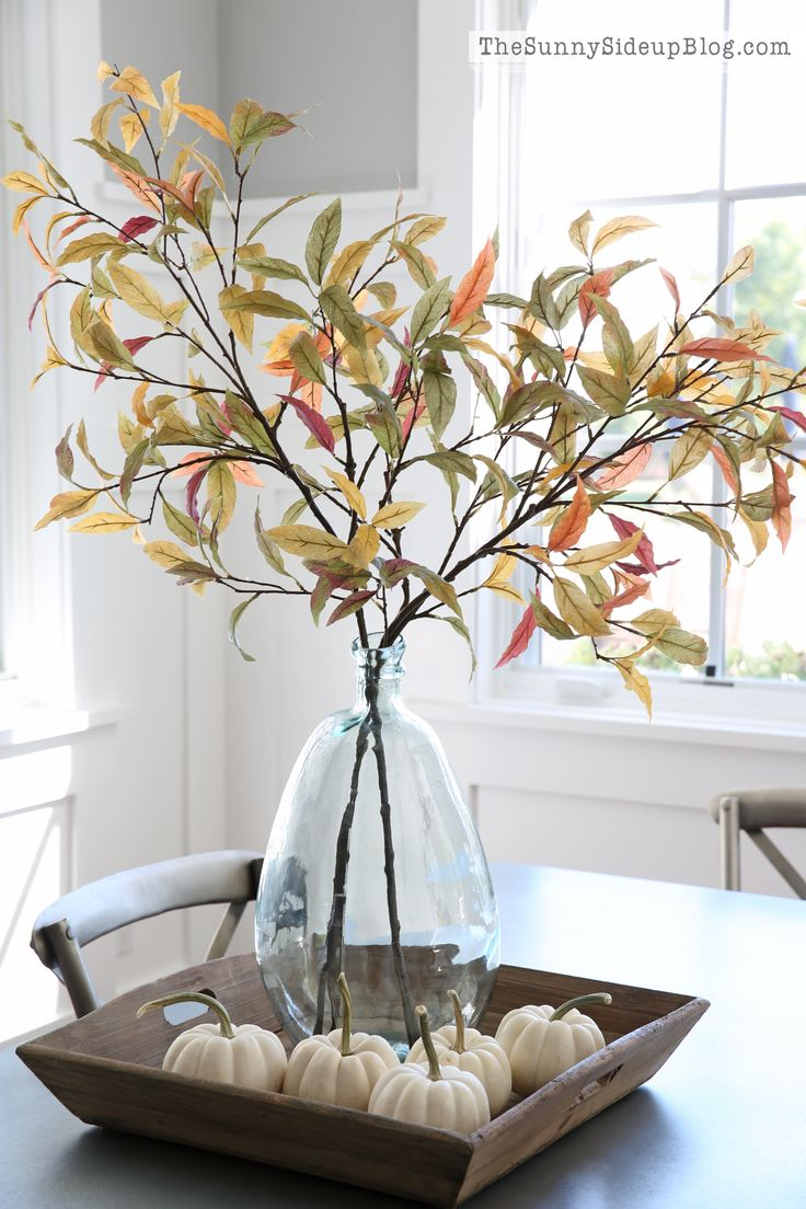 Pretty Fall Arrangement - branches of fall leaves in a cleat vase with mini white pumpkins in a wood tray. These are Pottery Barn artificial leaves