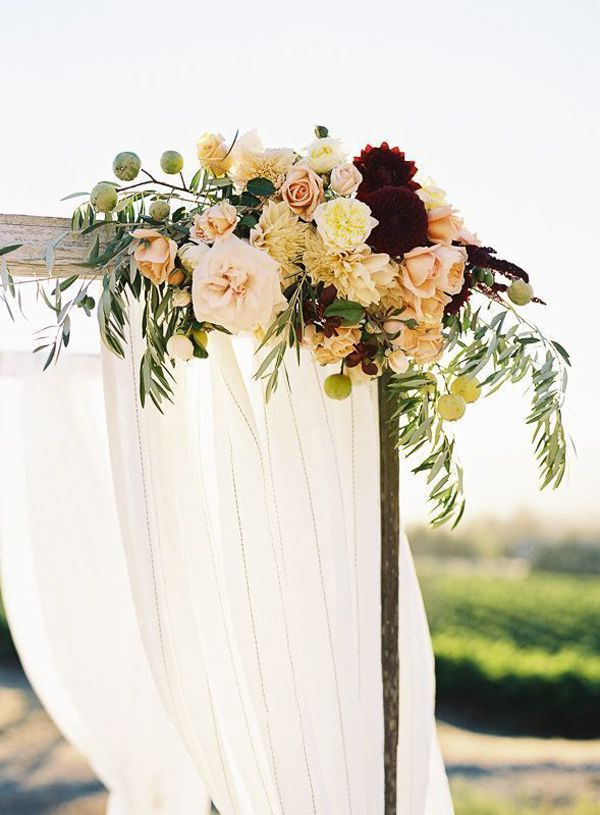 marsala and blush ceremony florals. Would be pretty on each side of the curtains where they are tied back.