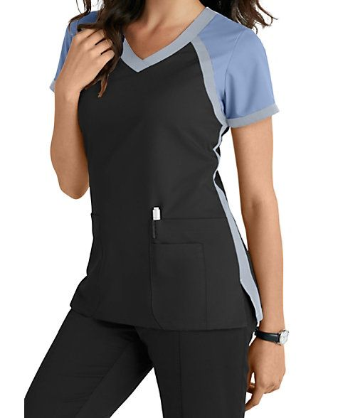 This athletically-inspired scrub top from the popular Grey's Anatomy brand gives you a fresh look for the season!  A color block crossover v-neck design highlights this delightful junior fit scrub top.  Three roomy pockets are included to hold your accessories.  Get all of your favorite colors!   Grey's Anatomy 3 Pocket Color Block V-neck Scrub Tops  V-neck  Junior fit  Three pockets  Fitted back  Medium Center Back Length 25 1/2