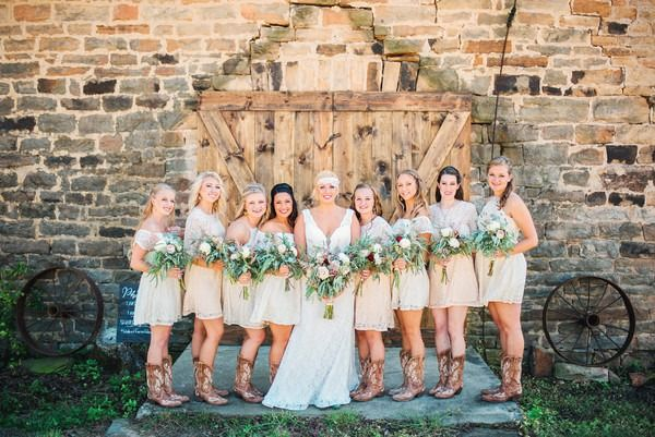 Rustic bridesmaids dresses - short, champagne-hued lace bridesmaid dresses with varying necklines and cowboy boots {Cody Krogman Photography}