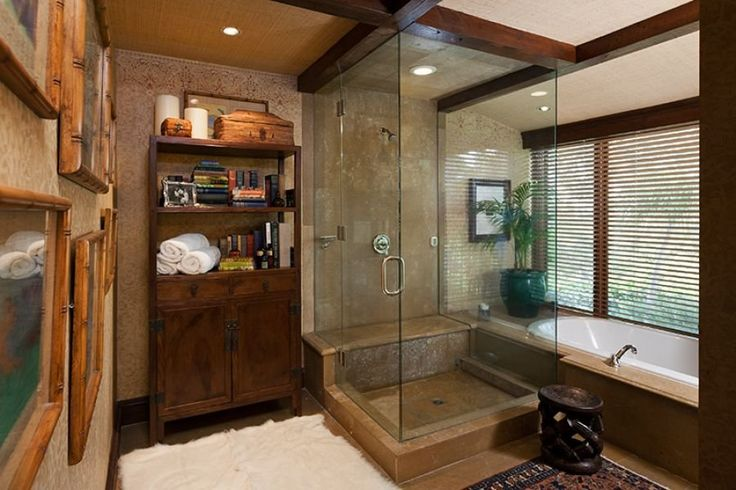 The bathroom has a steam shower, and views of the backyard.
