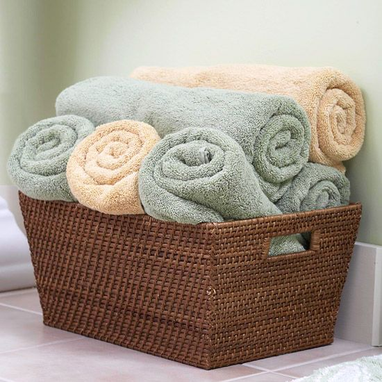 Basket Case...  Deep baskets provide storage and display space without the expense of built-ins or furniture. Roll up towels and pile them into open baskets near the shower for easy access.
