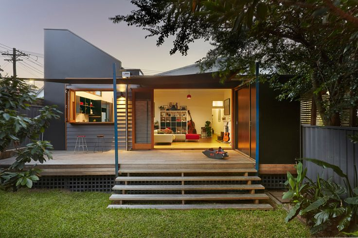 Very different house but same concept of wide open doors off living area and window at kitchen area. Maybe the bi-fold window at kitchen is better than a sliding window? I just worry people will bang into where it protrudes when open as the area between studio and kitchen will be a fairly narrow space.