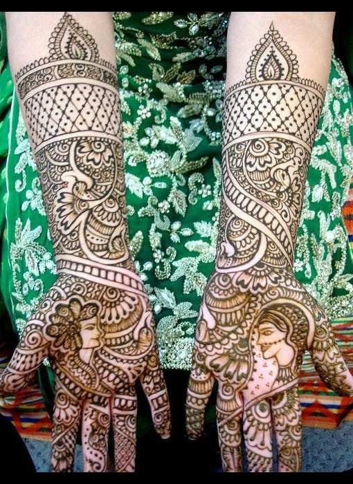 I love the dulha and dulhan in the mehndi design
