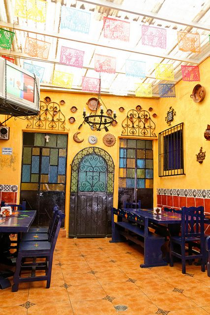 Restaurant, Puebla Mexico. I love those chairs with the little details in the middle.