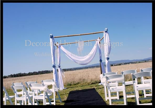 White outdoor gladiator chairs, white organza sashes, black aisle carpet, wedding arbour with white draping all for hire for your outdoor ceremony. Australia wide. Visit www.poshdesigns.com.au for more photos and info, or email lisa@poshdesigns.com.au for pricing packages.