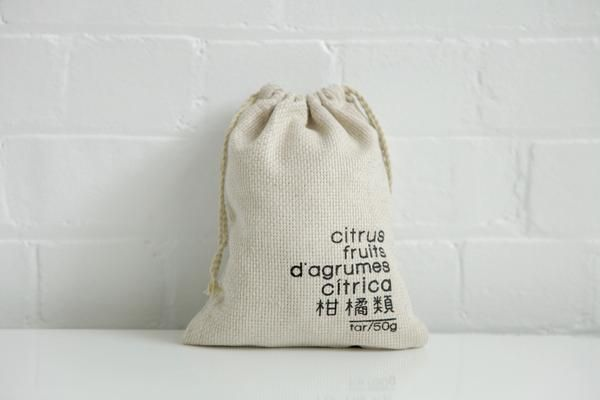 beautiful handmade hemp citrus produce storage bags marked with the unladden weight and categorised for