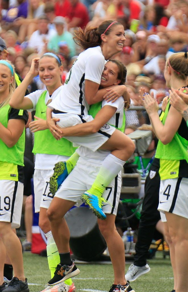 Alex Morgan and Tobin Heath after Morgan's goal against Haiti, Sept. 20, 2015. (Marvin Gentry/USA Today Sports)