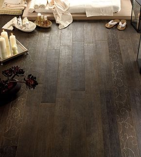 Suelos de ceramica Ceramic tile that looks like wood.....perfect for a bath or basement.