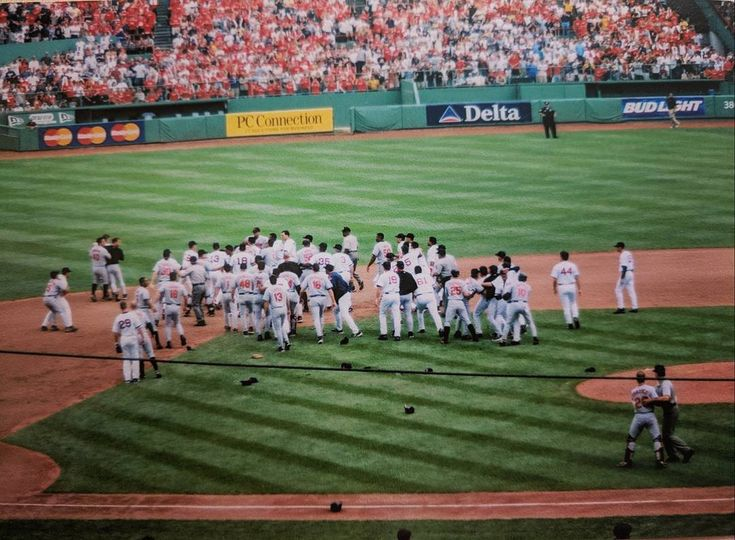 #tbt to an epic bench-clearing brawl on 7/29/2002 between the Boston Red Sox and Baltimore Orioles. I was teaching summer school and we had a field trip to Fenway Park -- only game I've ever attended there. What a lesson for the kids! 6 players received suspensions and another 8 were fined. Oh 'mrica.  #baseball #redsox #boston #bostonredsox #fenwaypark #orioles #baltimoreorioles #brawl #benchclearingbrawl #holdmeback #melvinmora