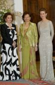 Lebanese First Lady Andree Lahoud (C) poses with her counterparts Suzanne Mubarak of Egypt (L) and Asma Assad of Syria during a night gala at the Lebanese presidential palace 07 March 2004. Lahoud, who chairs a national committee on women's issues, is hosting the two-day conference organized on the theme 'Woman and Armed Conflicts.' AFP PHOTO/Anwar AMRO (Photo credit should read ANWAR AMRO/AFP/Getty Images)
