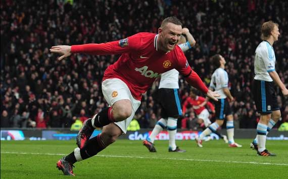 Wayne Rooney scored a quick brace after halftime to clinch a 2-1 win over Liverpool. Luis Suarez scored a late consolation, but talk will center around his refusal to shake Patrice Evra's hand pre-match.