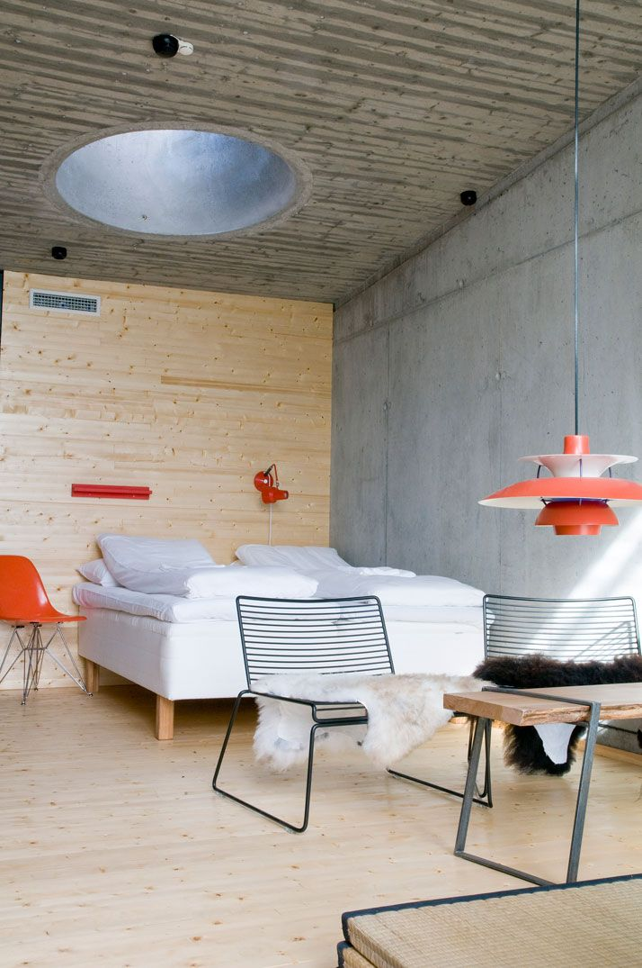 Oh yes! I'm in love with a mix of cement, wood and modern furniture and accessories. (Stokkøya Sjøsenter in Stokkøy, Norway)