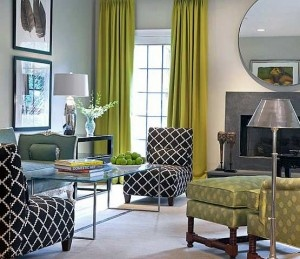 Gray living room, orange couch, green curtains. Have I been spending too much time at Hilton hotels? I love this look