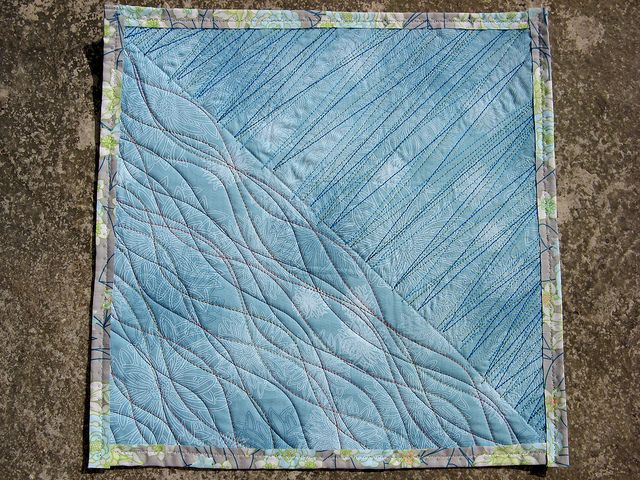 Freestyle quilting with the walking foot by stitchtress, via Flickr. Now this I could do.